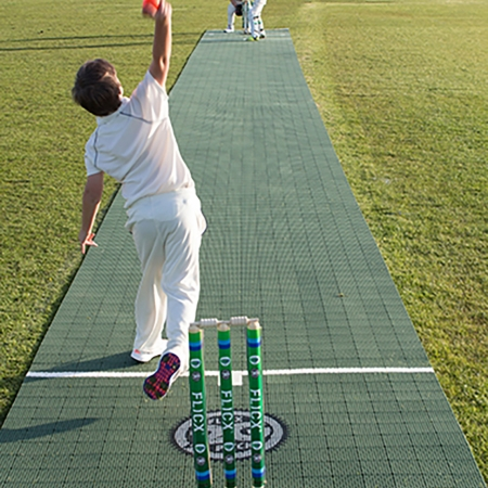 Image of a boy bowling on a Flicx Pitch outside